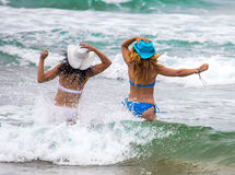 Two women on the beach Stock Images