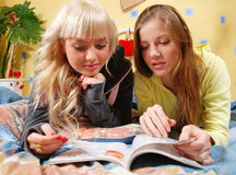 Two women at the bedroom Stock Photos