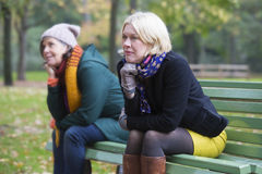 Two women on a bench in a park Stock Photo