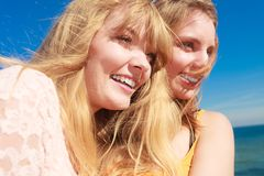 Two women best friends having fun outdoor. Two young women best friends blonde cheerful girls having fun outdoor wind blowing in hair. Summer happiness Royalty Free Stock Photo