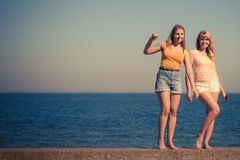 Two women best friends having fun outdoor. Two young women best friends blonde cheerful girls having fun outdoor by seaside. Summer happiness friendship concept Royalty Free Stock Photos