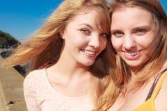 Two women best friends having fun outdoor Royalty Free Stock Image
