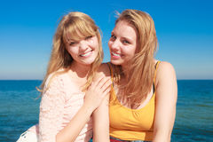 Two women best friends having fun outdoor. Two young women best friends blonde cheerful girls having fun outdoor wind blowing in hair. Summer happiness Stock Photo