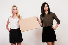 Two women with blank board Royalty Free Stock Images