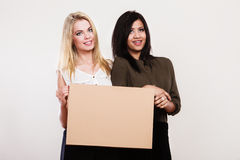 Two women with blank board Stock Photos
