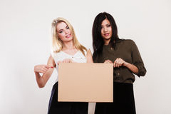 Two women with blank board Stock Image