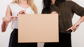 Two women with blank board Stock Photo