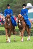 Two women from the Blue Star riding sidesaddle Stock Photo