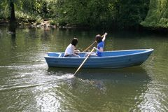 Two women in boat. On the river Royalty Free Stock Images