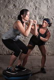 Two Women in Boot Camp Balance Training. Pretty European women on balancing equipment for boot camp workout Stock Images