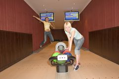 Two women bowling Royalty Free Stock Photo