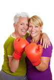 Two women with boxing gloves Stock Images