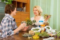 Two women brewing herbal tea Royalty Free Stock Photo