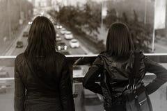 Two women on the bridge Stock Photos