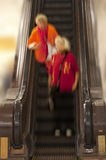 Women in old escalator Royalty Free Stock Photography