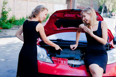 Two women in the broken car Stock Image