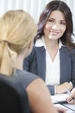 Two Women or Businesswomen in Office Meeting stock photography