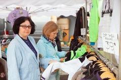 Two women buy jacket Stock Photo