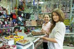 Two women  buying lipstick Royalty Free Stock Photo