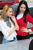 Two women buying a new car. Two young women buying a new car stock images
