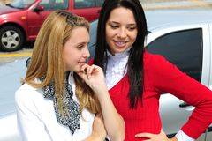 Two women buying a new car. Two young women buying a new car Royalty Free Stock Photos