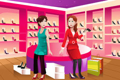 Two women buying shoes. A vector illustration of happy women buying shoes in a shoes store Stock Photo