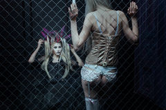 Two women in a cage. Royalty Free Stock Photography
