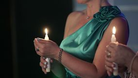 Two women with candles in hands. Shot stock video footage