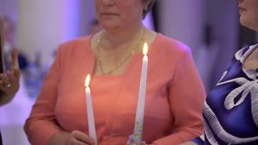 Two women with candles. At the party stock footage