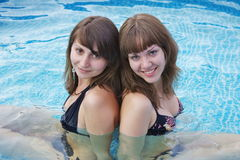 Two  women are by a canicular day Stock Images