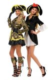 Two women in carnival costumes. Pirate and empress Royalty Free Stock Photography