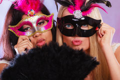 Two women with carnival venetian masks Stock Photo