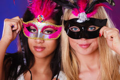Two women with carnival venetian masks Royalty Free Stock Photography