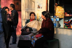 Two women catching up at tibet refugee place delhi Royalty Free Stock Image