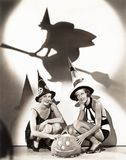 Two women celebrate a bewitching Halloween royalty free stock image