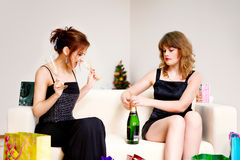 Two women celebrate christmas Stock Photo