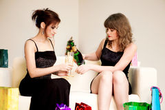 Two women celebrate christmas Stock Photos