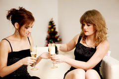 Two women celebrate christmas Royalty Free Stock Image