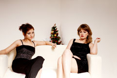 Two women celebrate christmas Stock Images