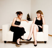 Two women celebrate christmas Royalty Free Stock Photography