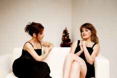 Two women celebrate christmas Royalty Free Stock Photo