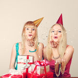 Two women celebrating birthday Royalty Free Stock Photos