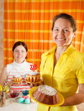 Two women celebrating Easter Stock Photography