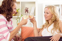Two women celebrating at home Stock Photos