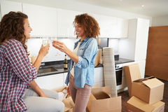 Two Women Celebrating Moving Into New Home With Champagne Stock Photography