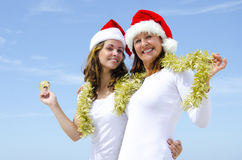 Two women celebrating sunny christmas holiday Stock Photo