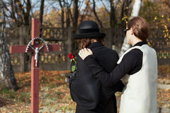 Two women at cemetery in fall Stock Photo