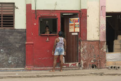Two women chatting over streetside store counter Havana stock photography