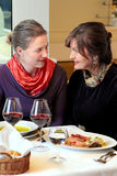 Two women chatting in restaurant Stock Image