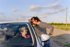 Two women chatting on a rural road Royalty Free Stock Photos